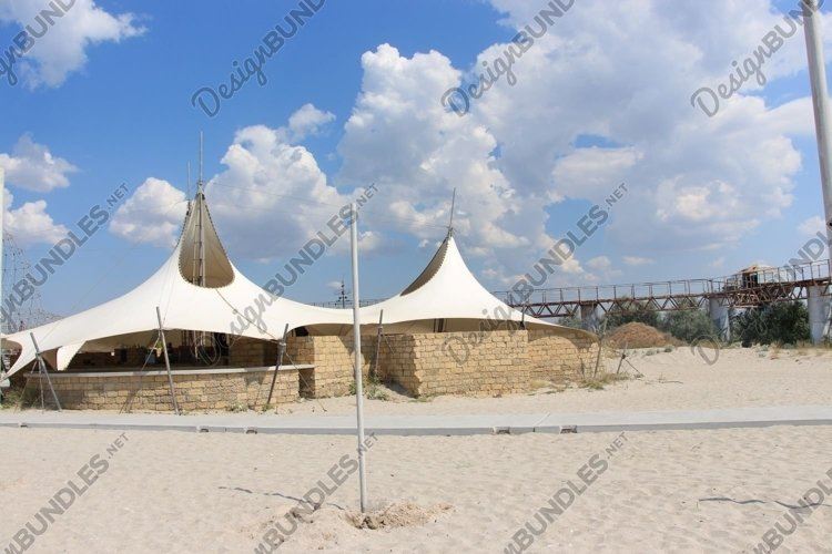 white tents-cafes on the beach example image 1