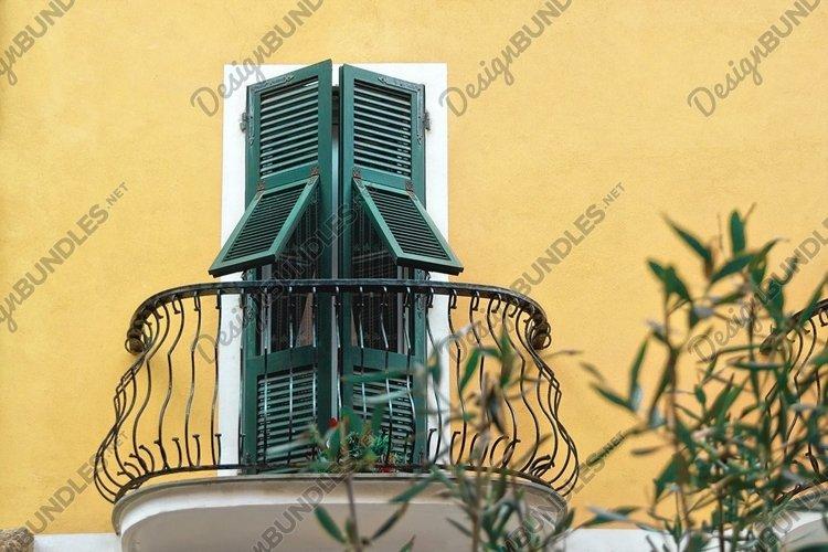 italian metallic black balcony with green wooden doors example image 1