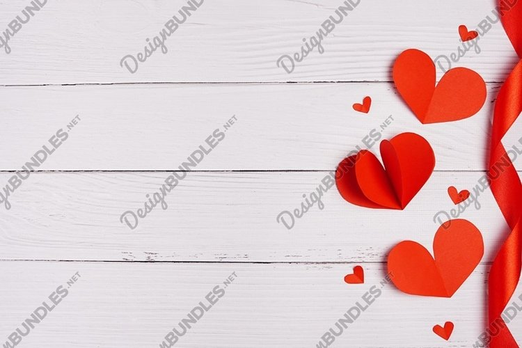 Paper hearts over white wooden background. Sainte Valentine example image 1