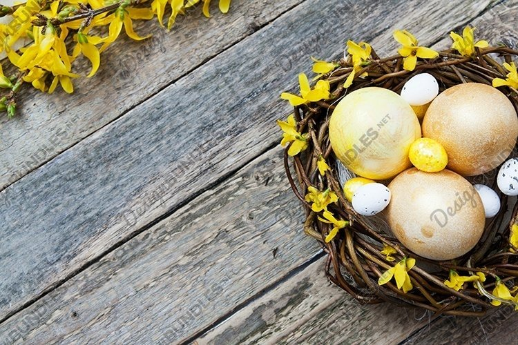 Nest with golden and yellow eggs with flowers on Wooden example image 1