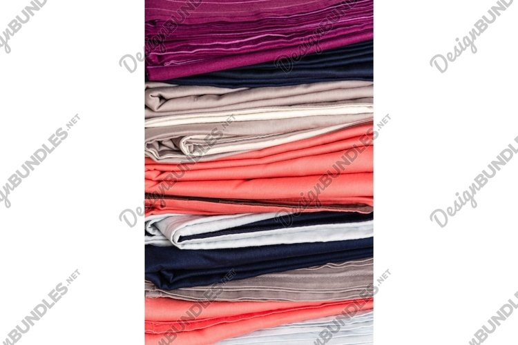 Stack of bed linen after laundry. Vertical background example image 1