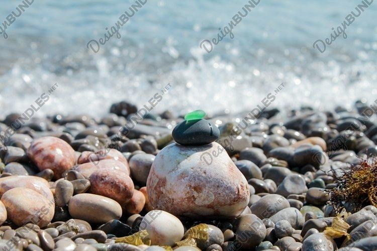 Pebble pyramid. Sea beach waves. Zen like. Copy space example image 1