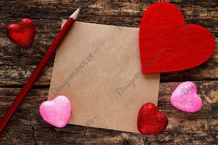 Background on Valentines Day heart pencil and a note