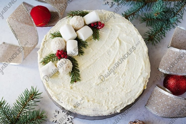 christmas cake with decor and fir branches on gray table example image 1