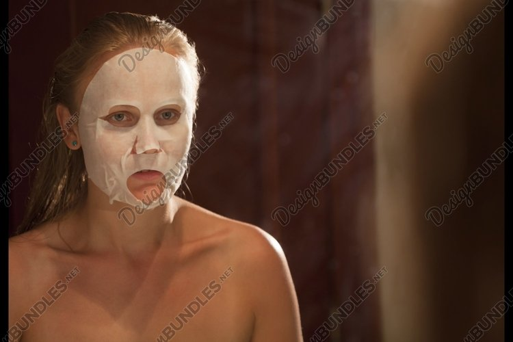 Applying of a facial mask example image 1