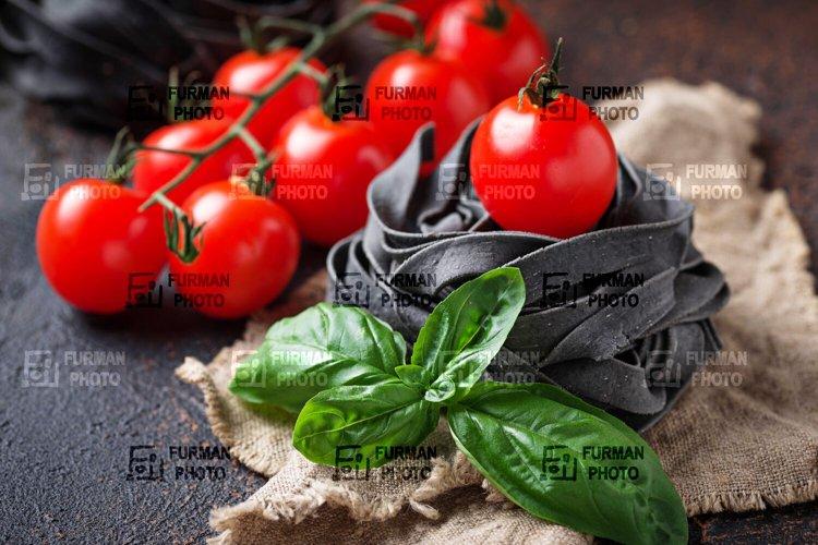 Black uncooked pasta tagliatelle example image 1