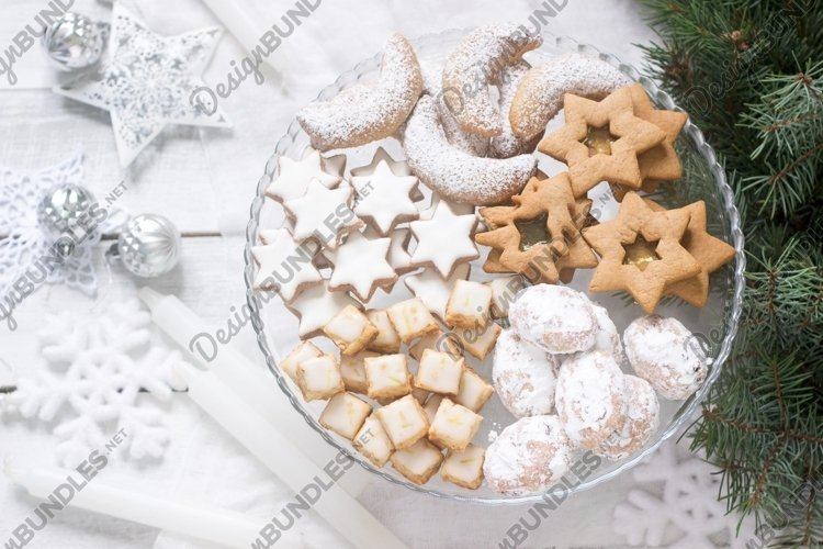 Various Christmas cookies on a transparent plate. example image 1