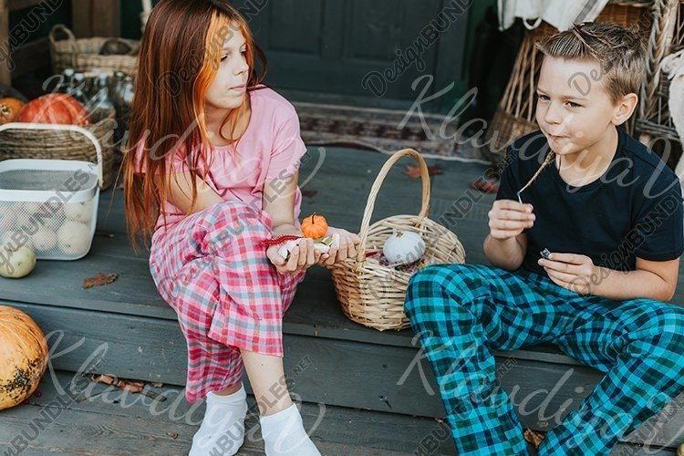children a boy and a girl in pajamas sharing candy example image 1
