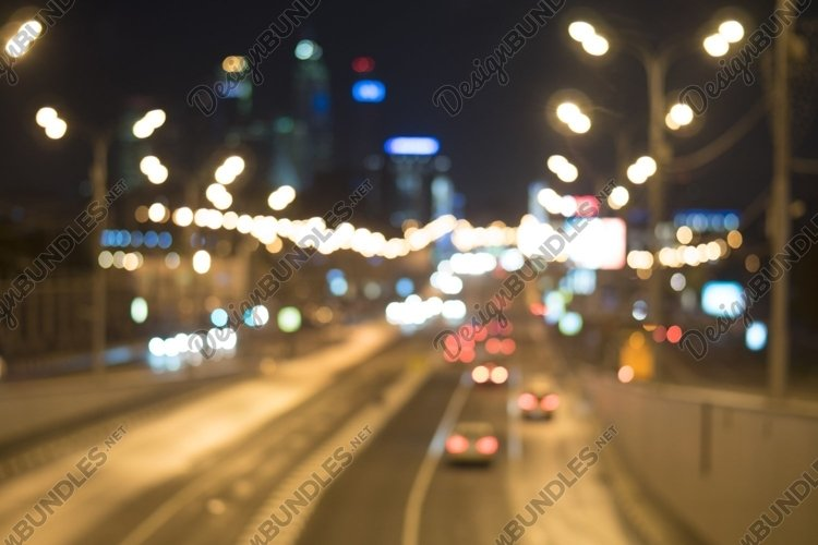 Blurred lights of city traffic at night example image 1
