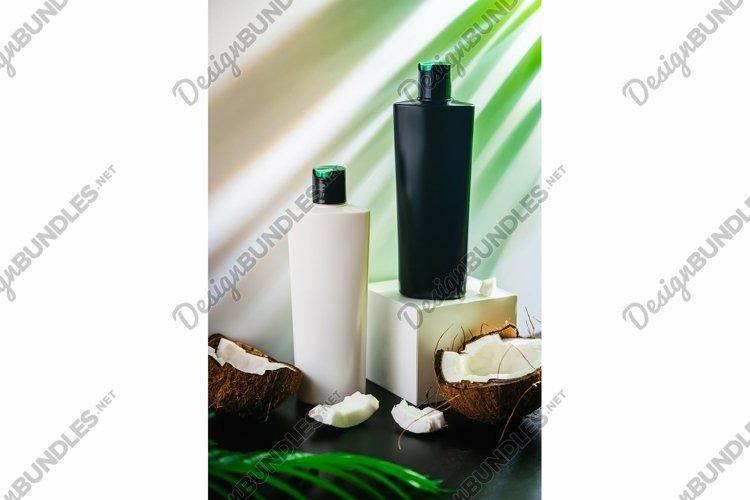 Photo of Shampoo and fresh organic coconut