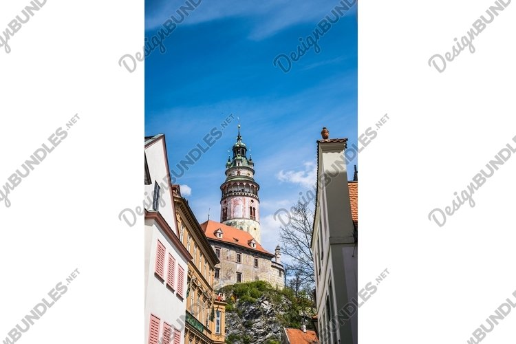 Tower of a medieval castle against a blue sky example image 1