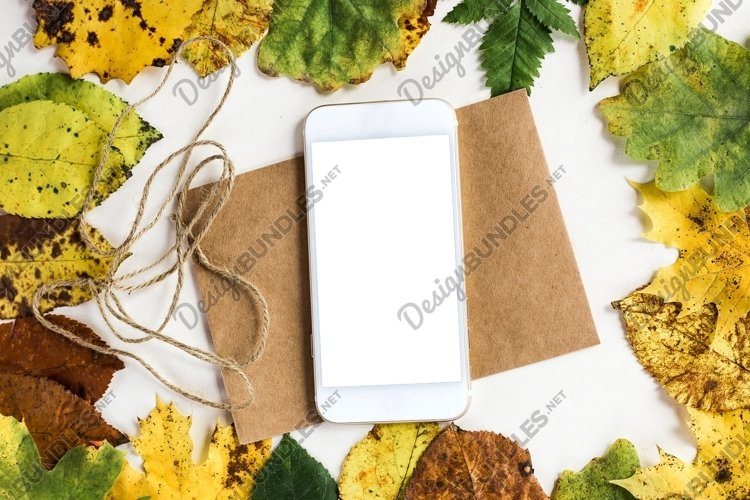 mobile lies on a postcard in autumn leaves example image 1