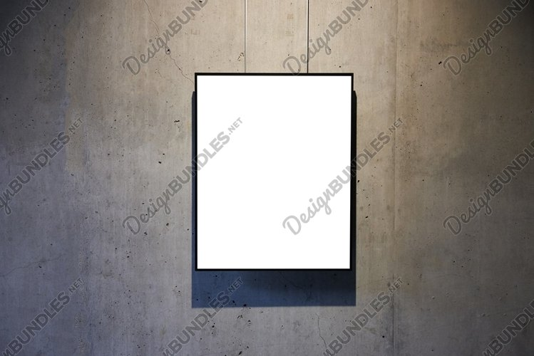Empty white isolated frame on the wall example image 1
