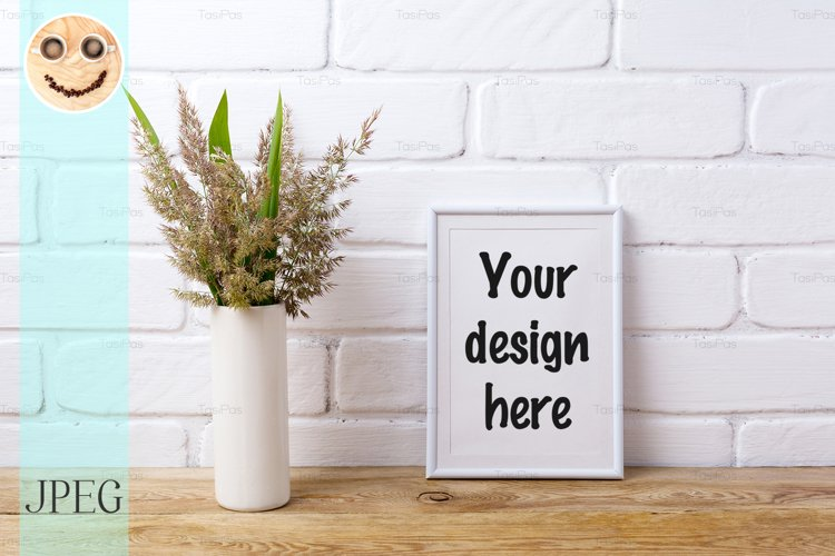 White frame mockup with grass and green leaves in vase example image 1