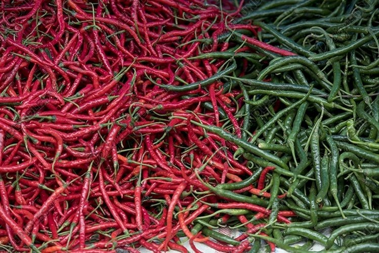 red chilies and green chilies are ready to be sold in the ma
