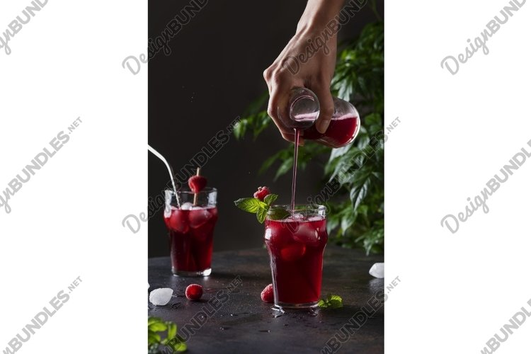 Fresh summer cold cocktail with raspberry, mint and ice. example image 1