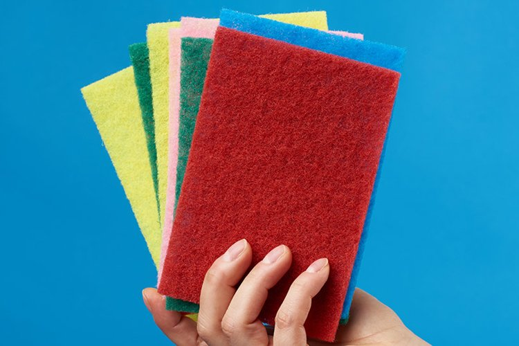 female hand holds stack kitchen sponges for washing dishes example image 1