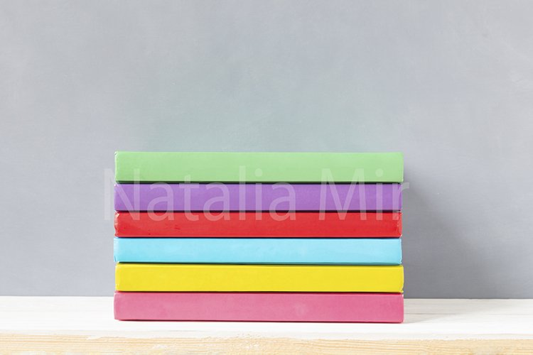 Children multicolour colourful books on a wooden shelf. example image 1