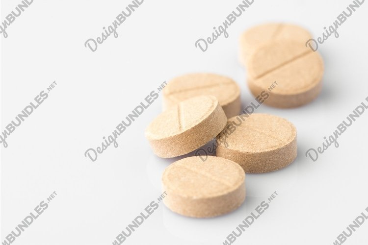 Tablets on a light background example image 1
