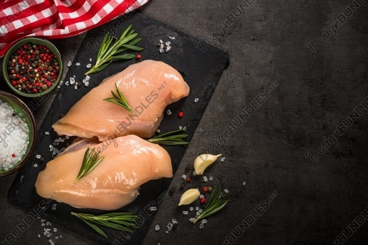 Chicken fillet at black background. example image 1