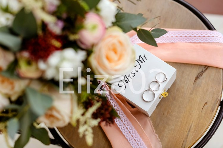 wedding rings and bouquet example image 1
