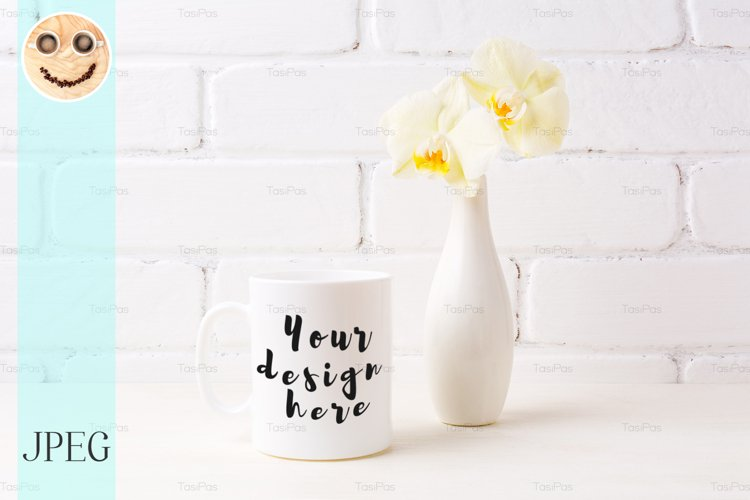 White coffee mug mockup with soft yellow orchid in vase example image 1