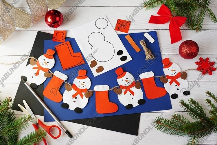 Making Christmas garland with snowmans from paper example image 1