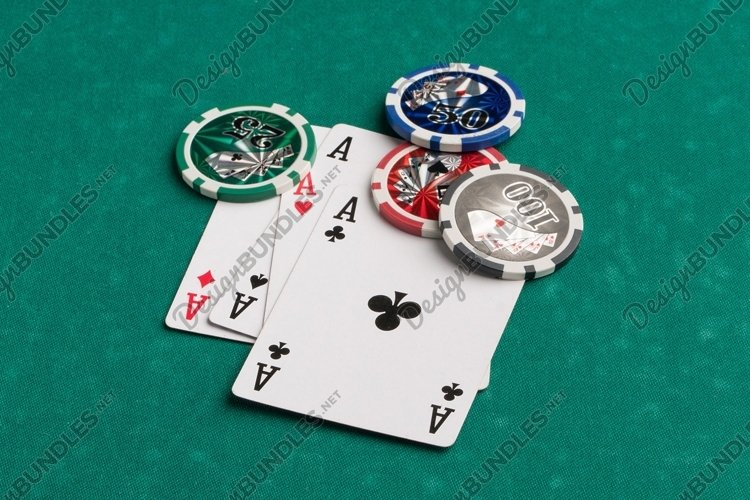 Poker chips and cards on a green. Casino and poker example image 1