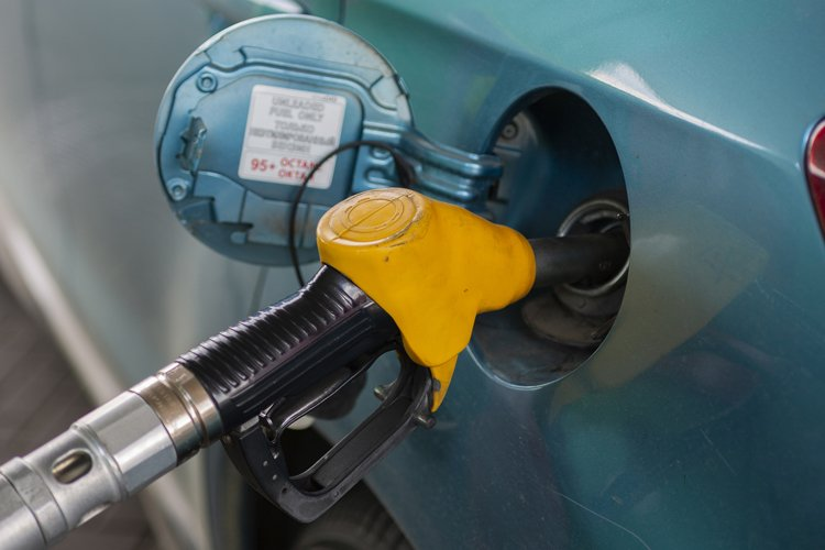 refueling the fuel tank of the vehicle with diesel example image 1
