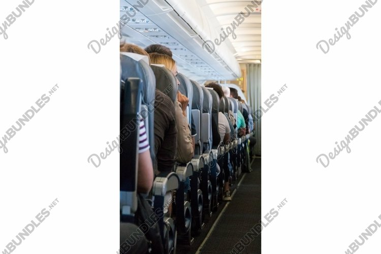 Passengers in the cabin airplane. The aircraft interior example image 1