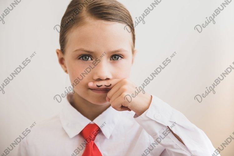 Beautiful child girl shows painted mustache