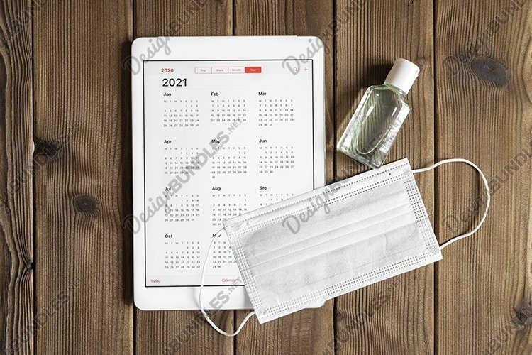 tablet with calendar for 2021. covid-19 protection concept example image 1