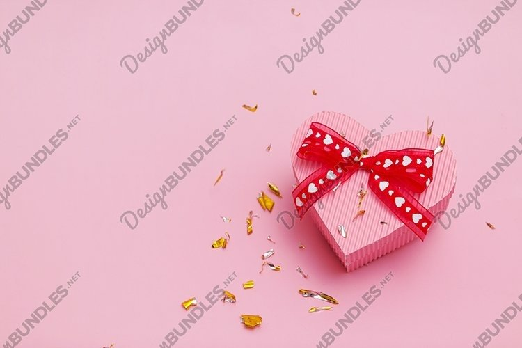 Heart shape gift box Valentine's day background example image 1
