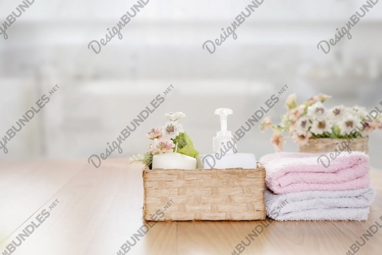 Towels on wooden top table with copy space on blurred. example image 1