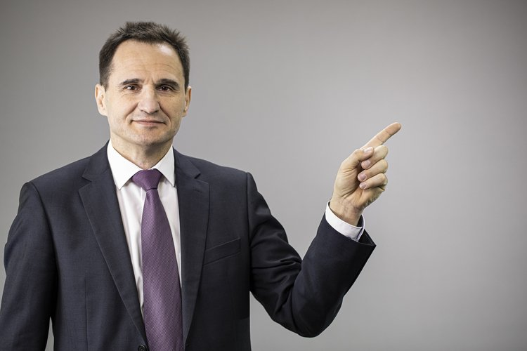 Portrait confident businessman on isolated gray background example image 1