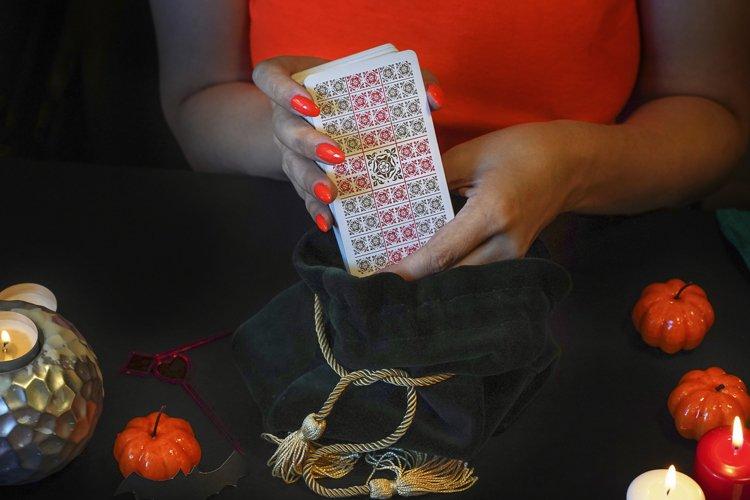 Tarot reader with tarot cards. Halloween concept, example image 1