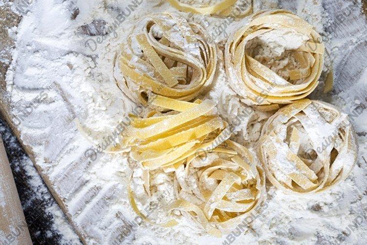raw pasta with white wheat flour example image 1