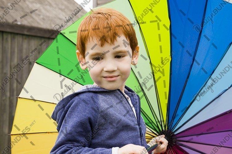 boy under an umbrella example image 1