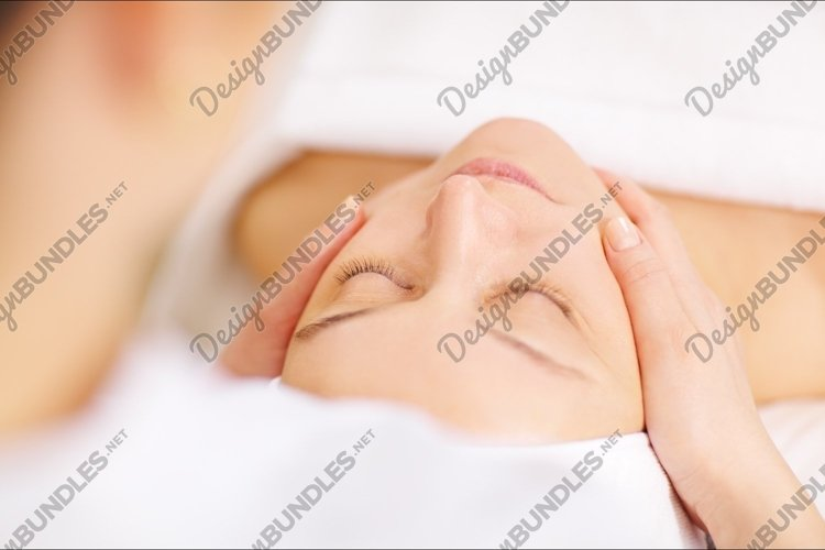 Woman under professional facial massage in beauty spa example image 1