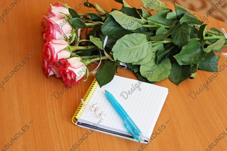 Bouquet of flowers and a Notepad with pen. example image 1