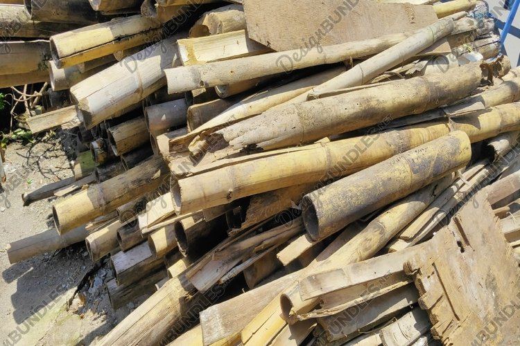 pile of long bamboo stacked high
