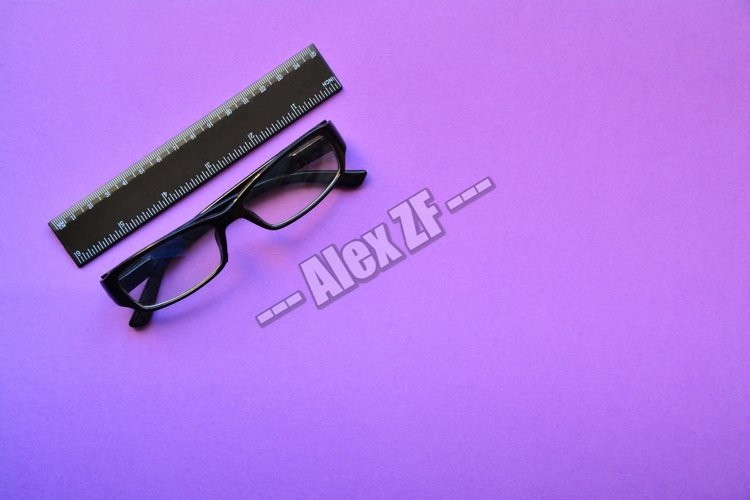 Glasses and a ruler on a purple background example image 1