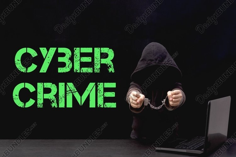hacker in a hood and handcuffs stands next to his laptop example image 1