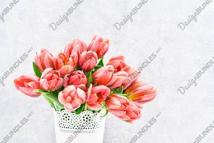 Pink tulips bouquet in white vase on light background. example image 1