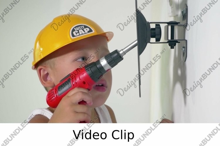 Video: Child playing a repair at home example image 1