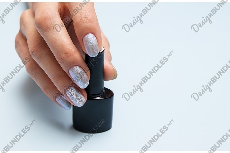 Winter manicure and a bottle of nail polish with copy space example image 1
