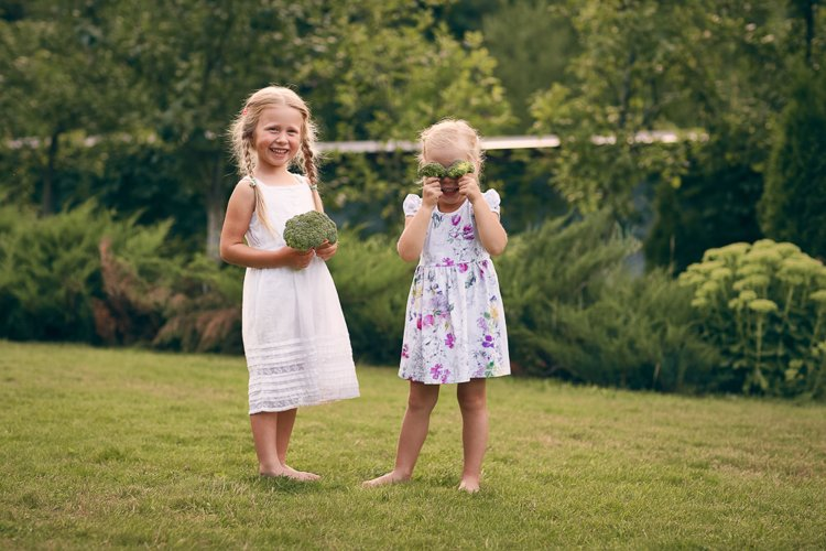 Children are holding broccoli. Healthy eating example image 1