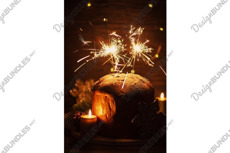 Typical Italian panettone and Sparklers on dark background example image 1