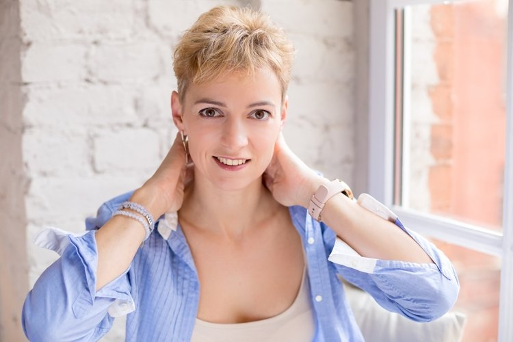 Portrait of happy woman with short blond hair