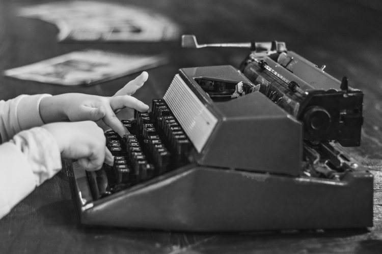 Vintage typewriter on a wooden table. example image 1